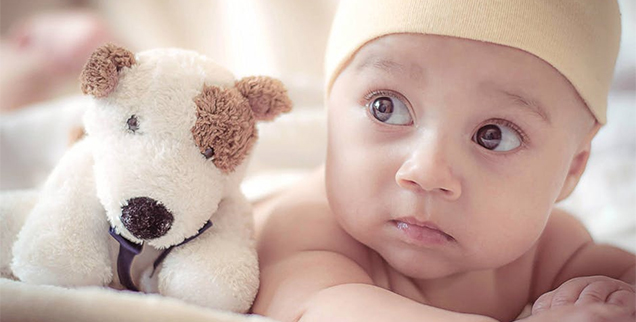 Baby with stuffed dog